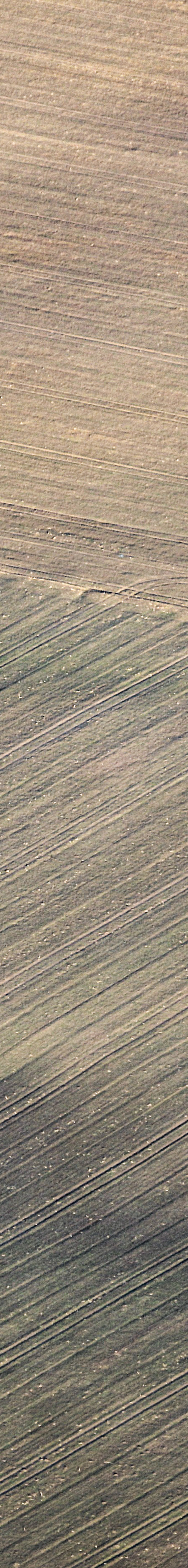 Aerial view of a leveled Celtic square jump, which is still visible as a ground feature - Klaus Leidorf Aerial Photography