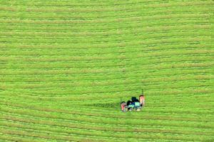 Aerial view of a tractor mowing a meadow - Klaus Leidorf Aerial Photography