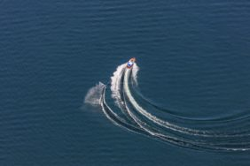Aerial view of a water skier pulled by motor boat on Lake Starnberg - Klaus Leidorf Aerial Photography