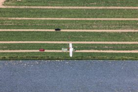 Aerial view of the cucumber harvest next to a red cabbage field - Klaus Leidorf Aerial Photography