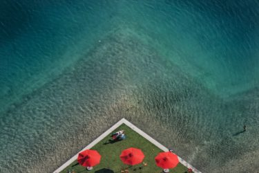 Aerial view of the grounds of the Federal Garden Show 2005 in Munich, swimming lake with three red parasols - Klaus Leidorf Aerial Photography