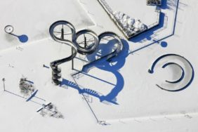 Aerial view of the water slide in Sommerbad-West in Munich-Pasing covered with snow in winter - Klaus Leidorf Aerial Photography
