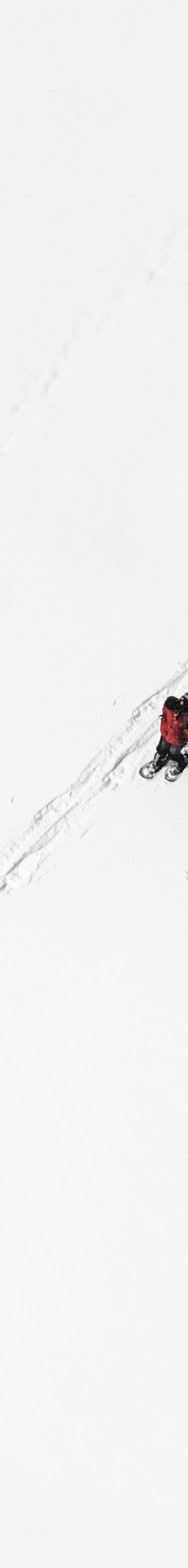 Aerial view of two hikers in the snow - Klaus Leidorf Aerial Photography