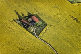 Aerial view of the Einödhof Hubstetten in the blooming rape field - Klaus Leidorf Aerial Photography
