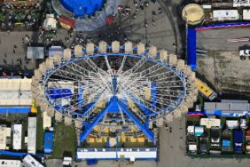 Aerial view of the Ferris wheel on the grounds of the Oktoberfest 2007 in Munich on the Theresienwiese - Klaus Leidorf Aerial Photography