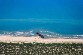 Aerial view of a shipwreck in Puglia on the beach - Klaus Leidorf Aerial Photography