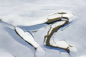 Aerial view of ice breaking on Forggensee - Klaus Leidorf Aerial Photography