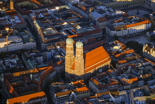 Aerial view of the Frauenkirche in the old town of Munich in the evening light - Klaus Leidorf Aerial Photography
