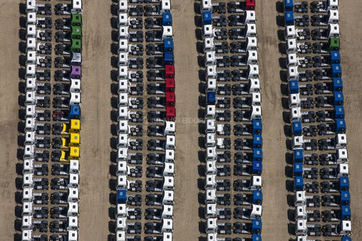 Aerial view of a storage car park for new MAN tractors - Klaus Leidorf Aerial Photography
