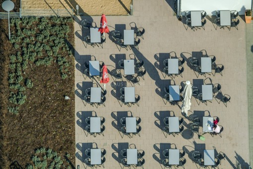 Aerial view of a person alone at the table of the rest area Autohof Hilpoltstein - Klaus Leidorf Aerial Photography