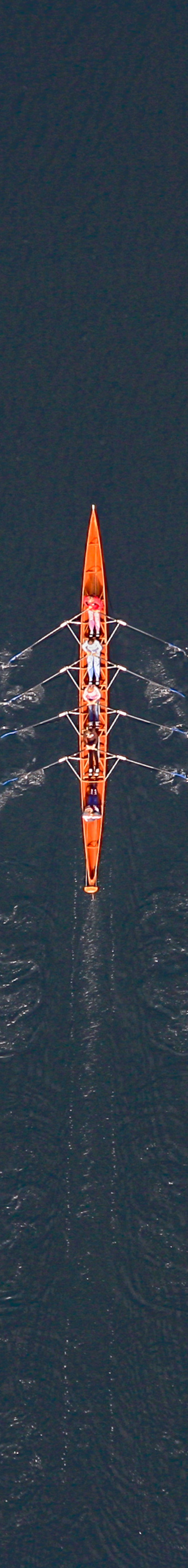 Aerial view of a rowboat on Lake Starnberg, a foursome with a helmsman - Klaus Leidorf Aerial Photography