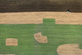Aerial view of a tractor doing field work - Klaus Leidorf Aerial Photography
