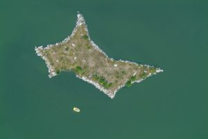 Aerial view of a yellow rubber dinghy on the island in Lake Erlauzwieseler near Waldkirchen - Klaus Leidorf Aerial Photography