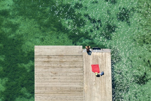 Aerial view of a vacationer on the jetty - Klaus Leidorf Aerial Photography