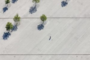 Aerial view of a stroller with dog on concrete surface - Klaus Leidorf Aerial Photography