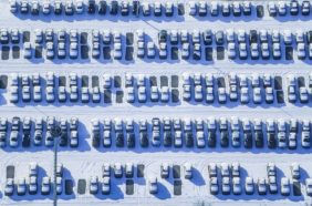 Aerial view of the delivery car park for new cars at the BMW plant in Dingolfing in winter - Klaus Leidorf Aerial Photography