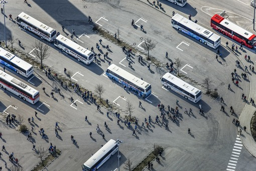 Aerial view of the bus parking lot at the BMW plant in Dingolfing at shift change - Klaus Leidorf Aerial Photography
