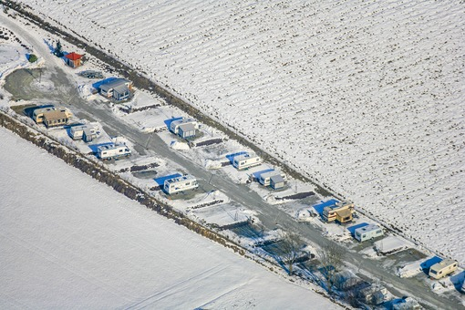 Aerial view of the Dreiquellenbad campsite in Griesbach im Rottal in winter - Klaus Leidorf Aerial Photography
