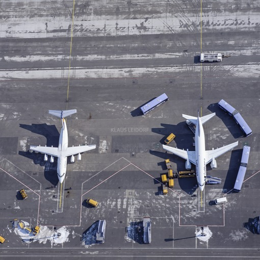 Aerial view of Munich Airport, aircraft at an outlying position, articulated buses waiting for passengers - Klaus Leidorf Aerial Photography