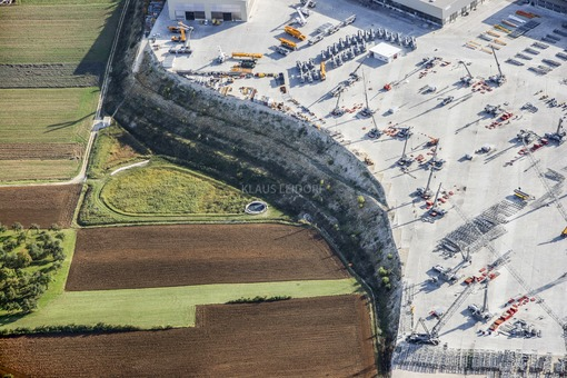 Aerial view of the Liebherr company's industrial estate north of Ehingen in an almost filled up valley - Klaus Leidorf Aerial Photography