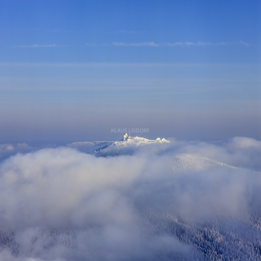 Aerial view of the Großer Arber in the Bavarian Forest, surrounded by clouds of fog - Klaus Leidorf Aerial Photography