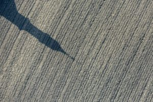 Aerial view of the shadow of the steeple of the chapel in Thal near Gars a.Inn - Klaus Leidorf Aerial Photography
