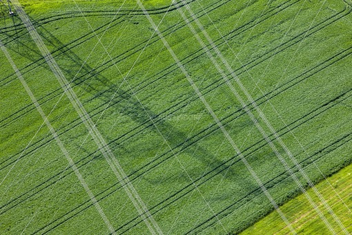 Aerial view of the shadow of a pylon under a power line - Klaus Leidorf Aerial Photography