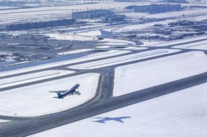 Aerial view of the launch of a Boeing 747 at Munich Airport in winter - Klaus Leidorf Aerial Photography
