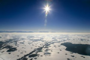 Aerial view of the wintry Alpine foreland against the light - Klaus Leidorf Aerial Photography