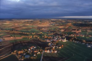 Aerial view of Aich, a village in Upper Bavaria, in the evening light - Klaus Leidorf Aerial Photography