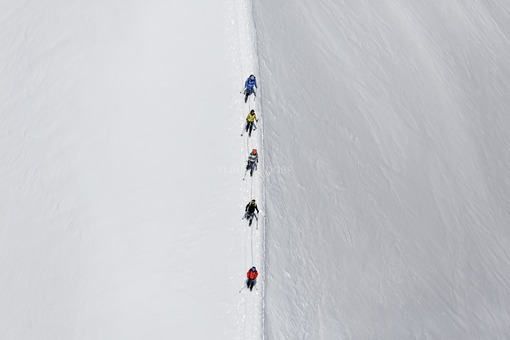 Aerial view of mountaineers on the glacier near the summit of the Großvenediger in the Hohe Tauern in Austria - Klaus Leidorf Aerial Photography