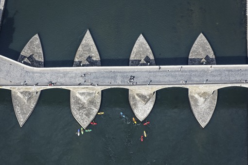Aerial view of kayakers at the stone bridge over the Danube in Regensburg - Klaus Leidorf Aerial Photography