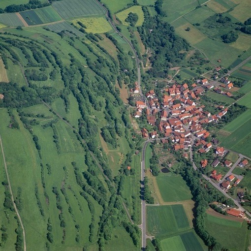 Aerial view of Leubach in the Rhön beside a hedgerow landscape - Klaus Leidorf Aerial Photography