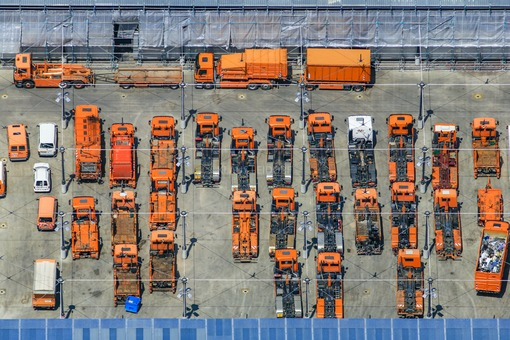 Aerial view of refuse collection vehicles of Stadtwerke München - Klaus Leidorf Aerial Photography