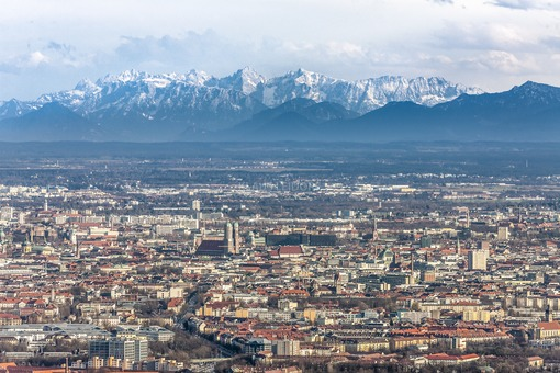 Aerial view of Munich in front of the alpine panorama with foehn weather - Klaus Leidorf Aerial Photography