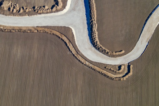 Aerial view of the construction site of the new access road to the Campeon in Unterbiberg - Klaus Leidorf Aerial Photography