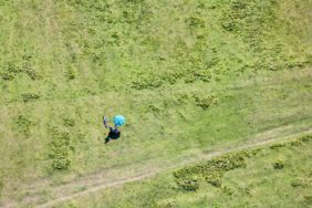 Aerial view of the Fröttmaninger Heide in Munich. At the parasol a paraglider is waiting for the updraft? - Klaus Leidorf Aerial Photography