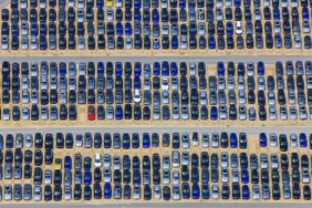Aerial view of a distribution warehouse for new BMW vehicles with only one red copy - Klaus Leidorf Aerial Photography