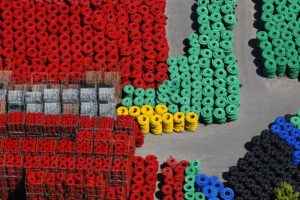 Aerial photograph of a storage area for plastic pipes made of polyethylene - Klaus Leidorf Aerial Photography