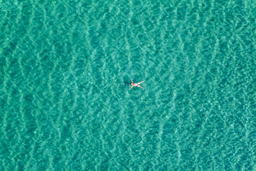 Aerial view of a swimmer in Starnberger See - Klaus Leidorf Aerial Photography