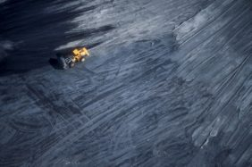 Aerial view of a yellow wheel loader on a coal dump - Klaus Leidorf Aerial Photography