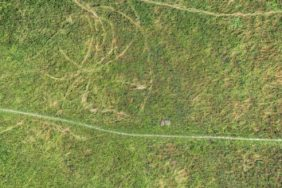 Aerial view of a lying bicycle on a meadow in Paul-Diehl-Park - Klaus Leidorf Aerial Photography