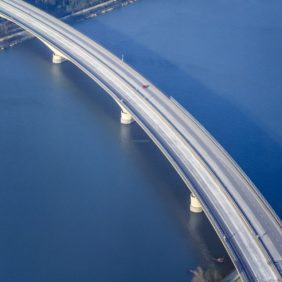 Aerial view of a red car on the motorway bridge near Neuhaus am Inn - Klaus Leidorf Aerial Photography