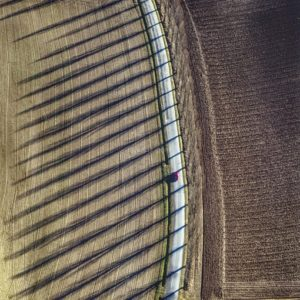 Aerial view of a red car on a country road with a row of poplars on the road between Oberwalting and Obersunzing, which have all been felled in the meantime - Klaus Leidorf Aerial Photography