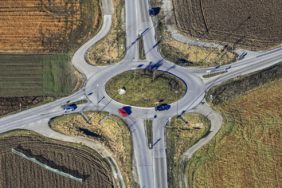 Aerial view of a red car in a roundabout - Klaus Leidorf Aerial Photography