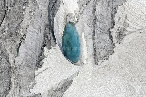 Aerial view of a turquoise lake in the glacier of the Ötztal in Tyrol near the Weißseespitze - Klaus Leidorf Aerial Photography