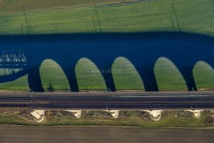 Aerial view of a railway line with shadow - Klaus Leidorf Aerial Photography