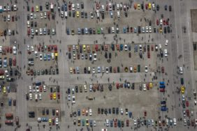 Aerial view of a classic car show on the Theresienwiese in Munich. Many visitors of the spring festival marvel at the historic vehicles - Klaus Leidorf Aerial Photography