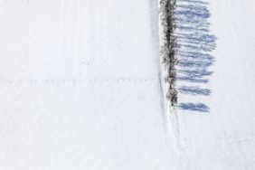 Aerial view of a row of shadow-casting birches in the snow - Klaus Leidorf Aerial Photography