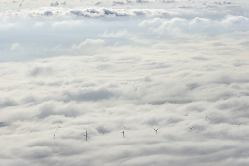 Aerial view of a cloud scenery with emerging wind turbines - Klaus Leidorf Aerial Photography